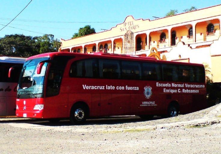 Red Mercedes-Benz coach